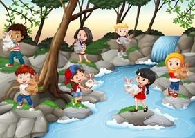 Children having fun at the waterfall