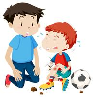 jeune homme aide à blesser un joueur de football
