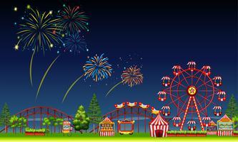 Cena do parque de diversões à noite com fogos de artifício