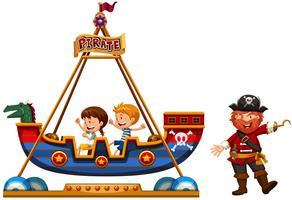 Children riding on viking ride with pirate