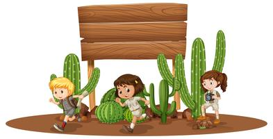 Wooden board with three kids in desert