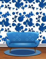 Blue sofa in room with blue splash wallpaper
