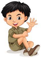 Kleine jongen zwaaiende hand