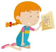 Une fille tenant une feuille de travail