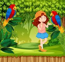 En röd hårflicka i djungel med papegoja