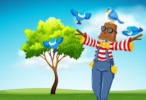 Scarecrow with blue birds scene