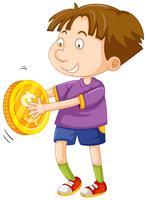 Glad pojke med guldmynt
