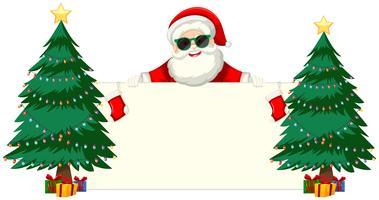 Santa con occhiali da sole in possesso di cornice vuota