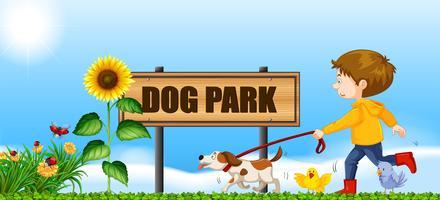 Niño paseando a su perro en el parque para perros
