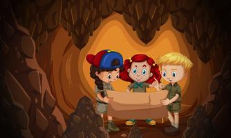 A group of children reading cave map