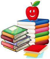 Stack böcker med äpple på toppen