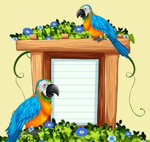 Paper template with two macaw birds vector