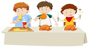 Three boys eating chicken and pizza at the dining table