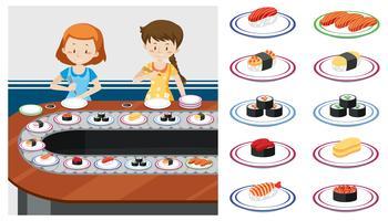 Två pojkar på ett Sushi-tåg