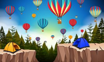 Hot air balloon in nature landscape