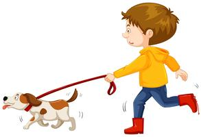 Little boy walking dog