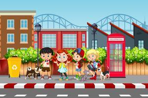 Cena de rua de crianças e animais de estimação