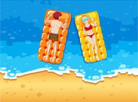 Man and woman sunbathing on the seaside