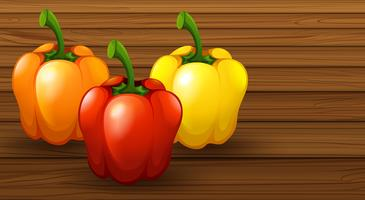 Three Different Bell Pepper on Wooden Background