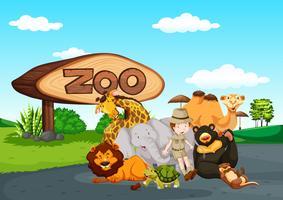 Escena del zoológico con muchos animales salvajes.