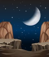 A stone cliff scene at night