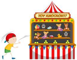 Junge, der Spielzeugknockout am Karneval spielt
