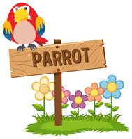 Red parrot on wooden sign