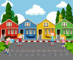 Children Playing in Front of Colourful Houses