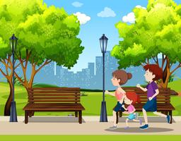 Family running in park scene