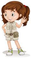 Ein nettes Mädchen, das eine Safariausstattung trägt