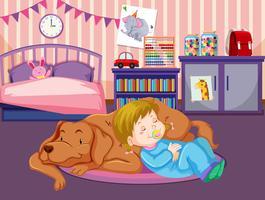 En baby sover med hunden