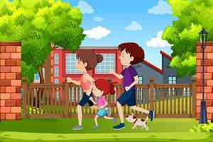 Una familia corriendo en el parque.