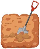 Shovel digging the soil