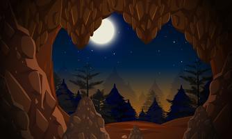 Uma entrada de caverna à noite