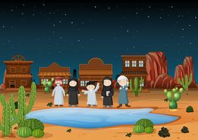 Los árabes de pie en la tierra del desierto en la noche