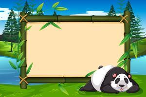 Um panda no quadro de bambu