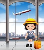 Japansk tjej på flygplatsterminalen
