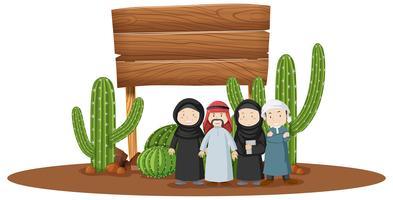 Träskylt med arabiska personer under