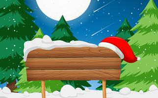 Wooden sign with santa hat scene