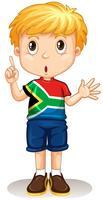 Sydafrikansk pojke pekar på hans finger