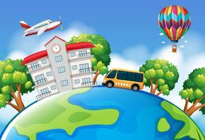 Schulbus und Gebäude auf der Erde