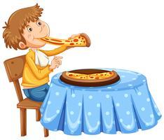 Mann, der auf dem Tisch Pizza isst