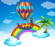 Kinder fahren mit dem Ballon über dem Regenbogen
