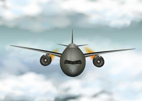 Gray airplane flying through the clouds