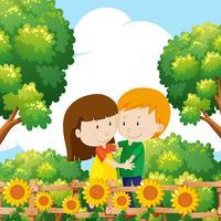 Boy and girl hugging in garden