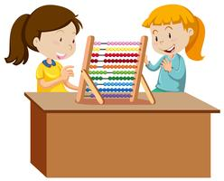 Two young girls playing with an abacus