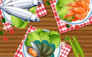 Seafood set on wooden table vector