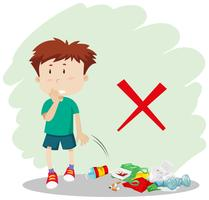 Ein Junge wirft Müll auf der Straße