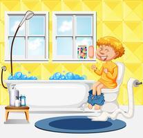 Een jongen zit op het toilet