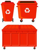 Three red rubbish bins